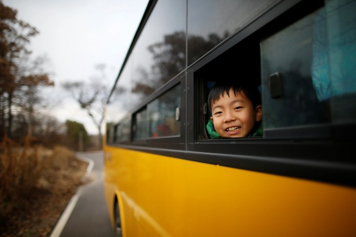 A child looks out from a school bus at the Daesungdong Elementary School.