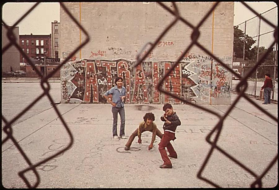 """Three boys and """" A Train"""" graffiti in Brooklyn's Lynch Park."""