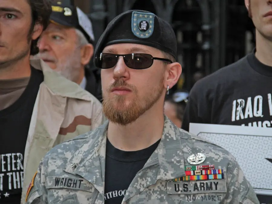 All types of vets were marching —this former soldier was pushing his daughter in a stroller.