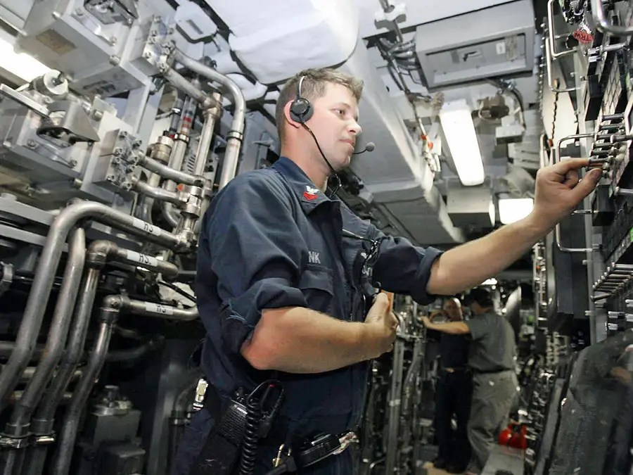 Here an officer on the USS Texas fires water through the torpedo tubes as part of a test
