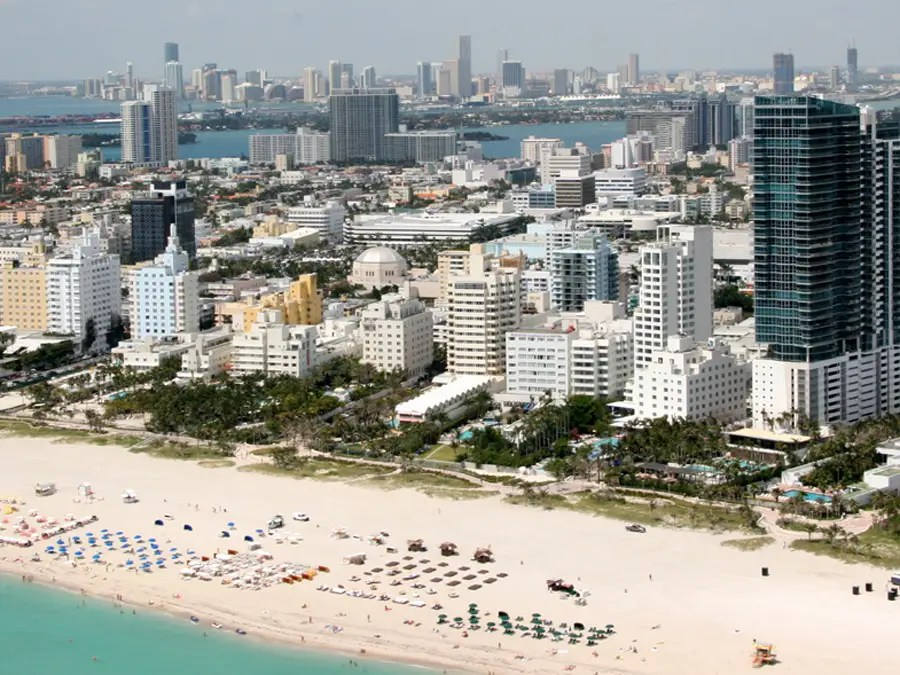 Miami Beach, Florida, wins for its wide swaths of sand filled with glamorous and beautiful people and its bumping nightlife. Come here to see and be seen.