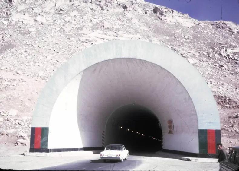 A nice car drives through a nice tunnel.