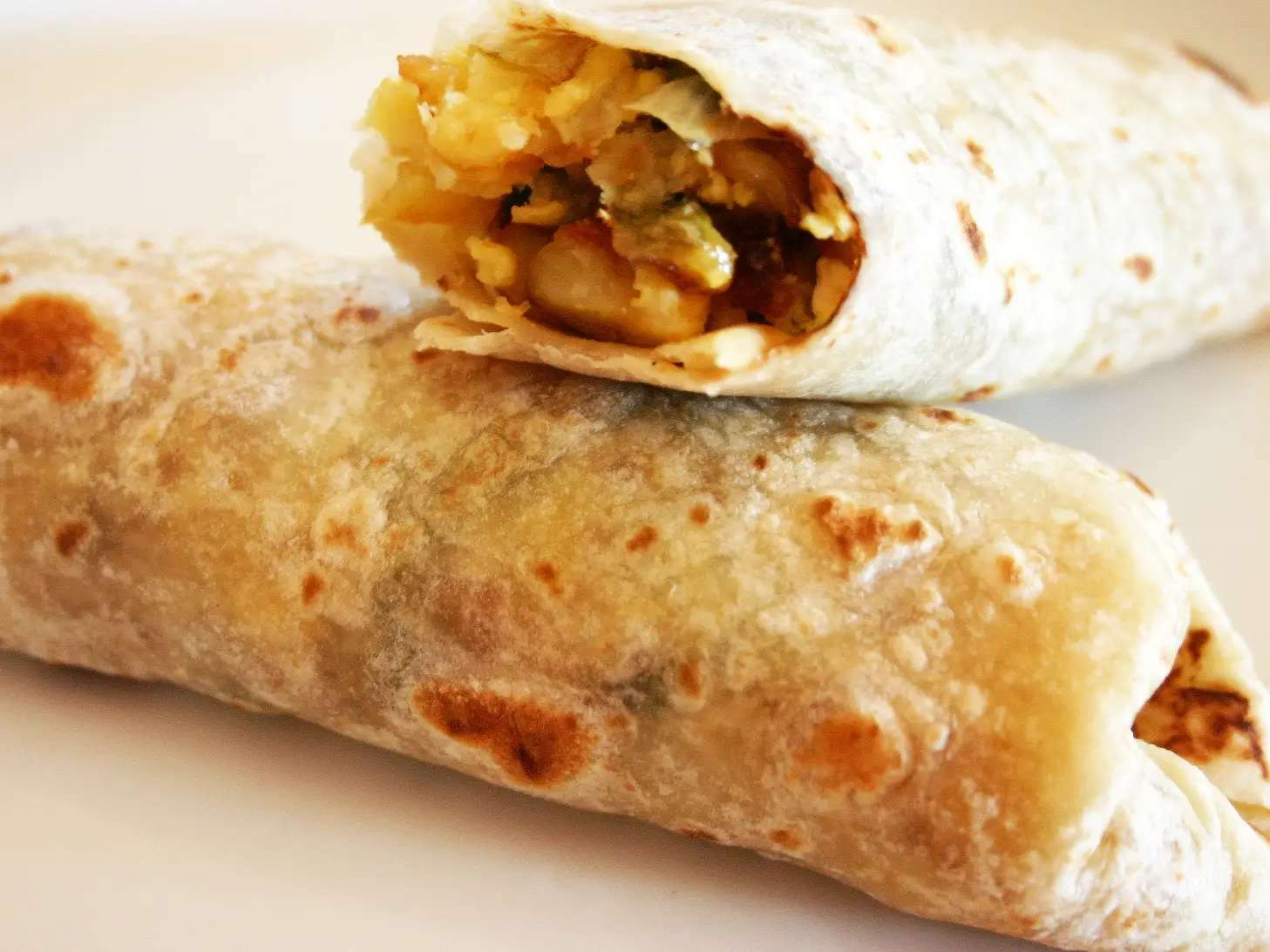 To keep wraps and burritos from falling apart, warm your tortilla before you start rolling everything together. Just for a 10 seconds on each side in a pan, or quickly in the microwave — you'll be surprised how well your wrap stays together.