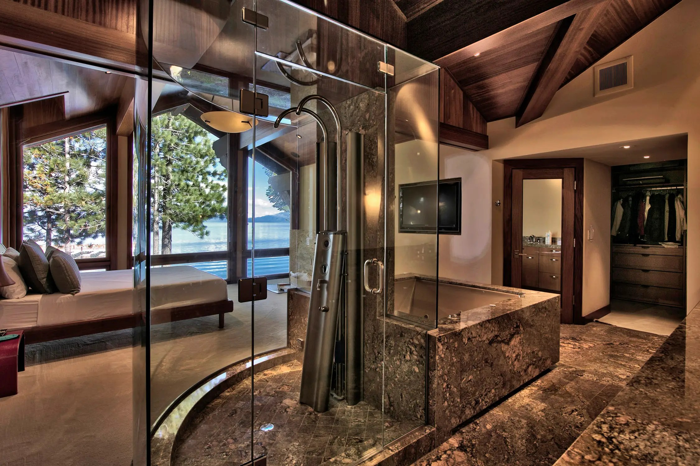 "... an all-glass shower designed to extend the master bedroom's lake views into the bathroom. Ms. Mansouri calls this her ""spa bedroom."""