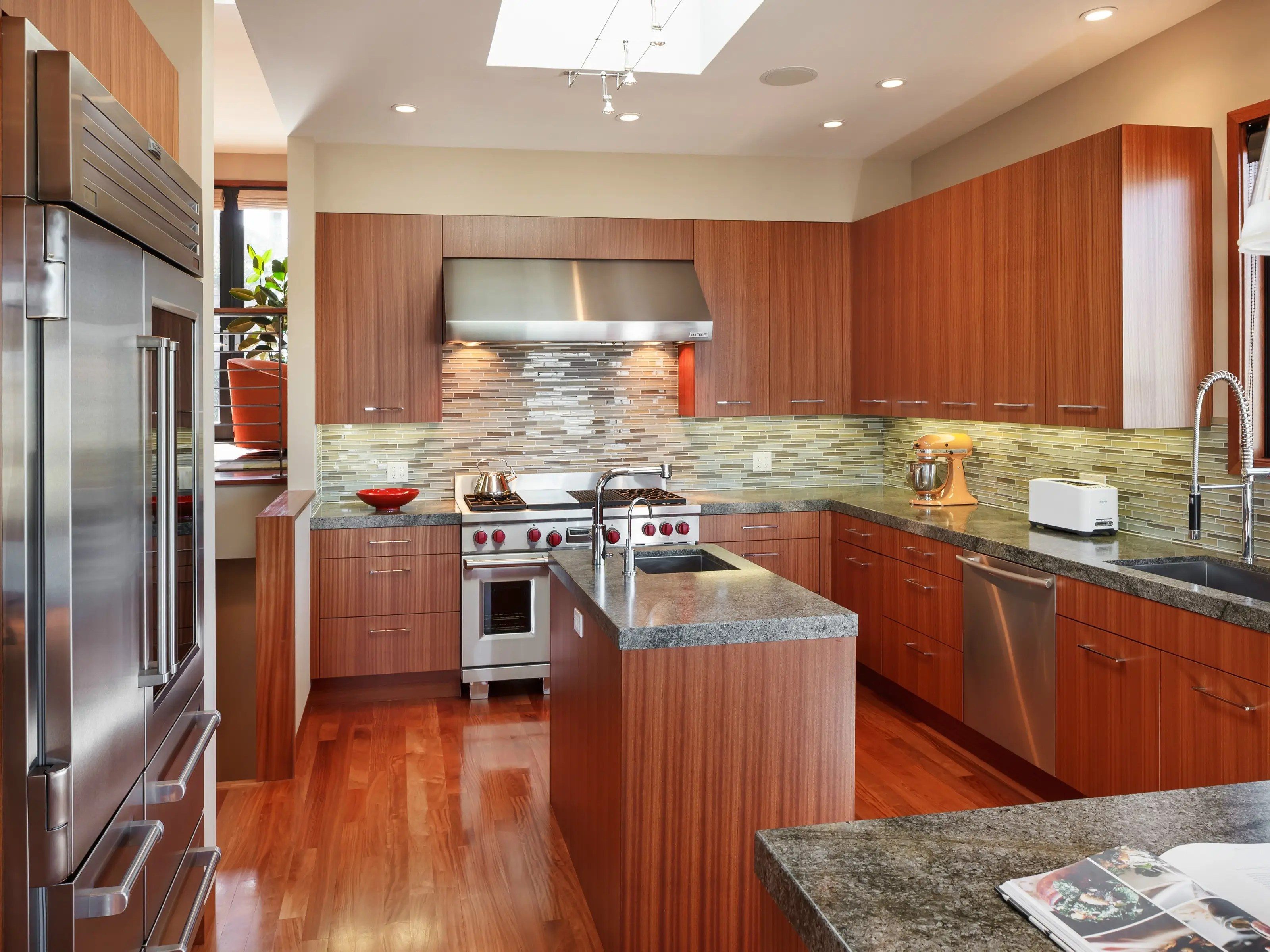 The kitchen is built for cooks, with plenty of storage space and a prep island with a sink in the center.