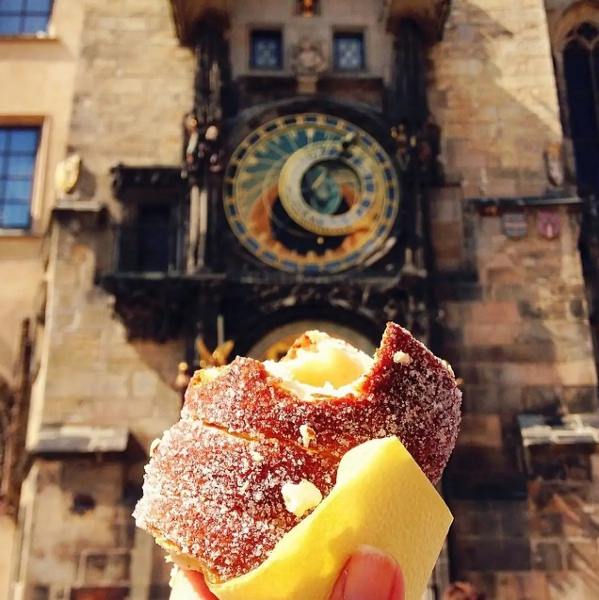Trdelník in front of the Astronomical Clock in Prague, which is possibly the most impressive clock I have ever seen.