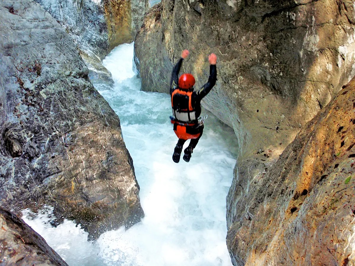 Go canyoning in Interlaken, Switzerland: rappel, raft, and jump through waterfalls.