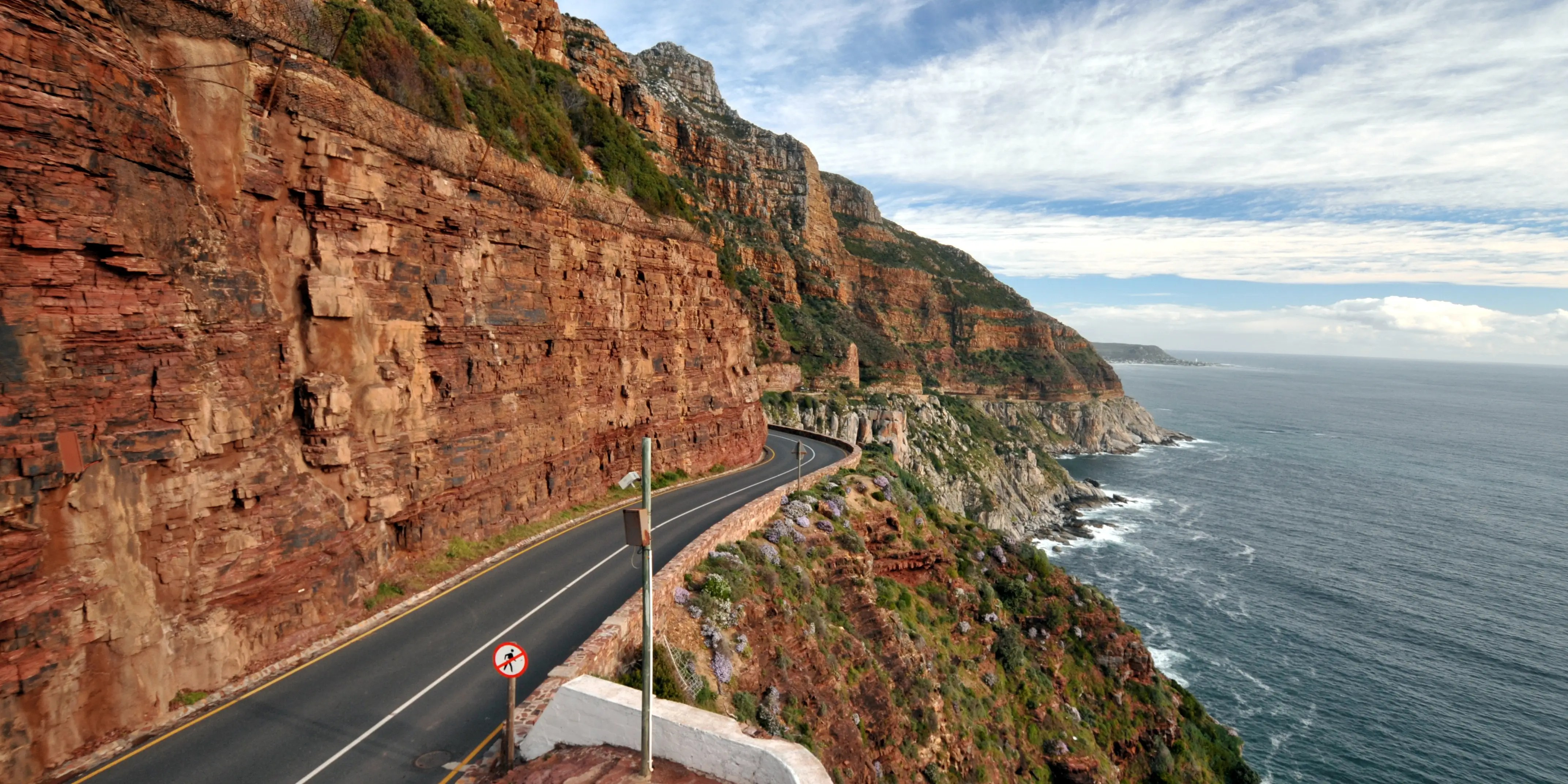Chapman's Peak Drive in South Africa is about five miles long with 114 curves and offers stunning 180-degree views of both mountain and sea.