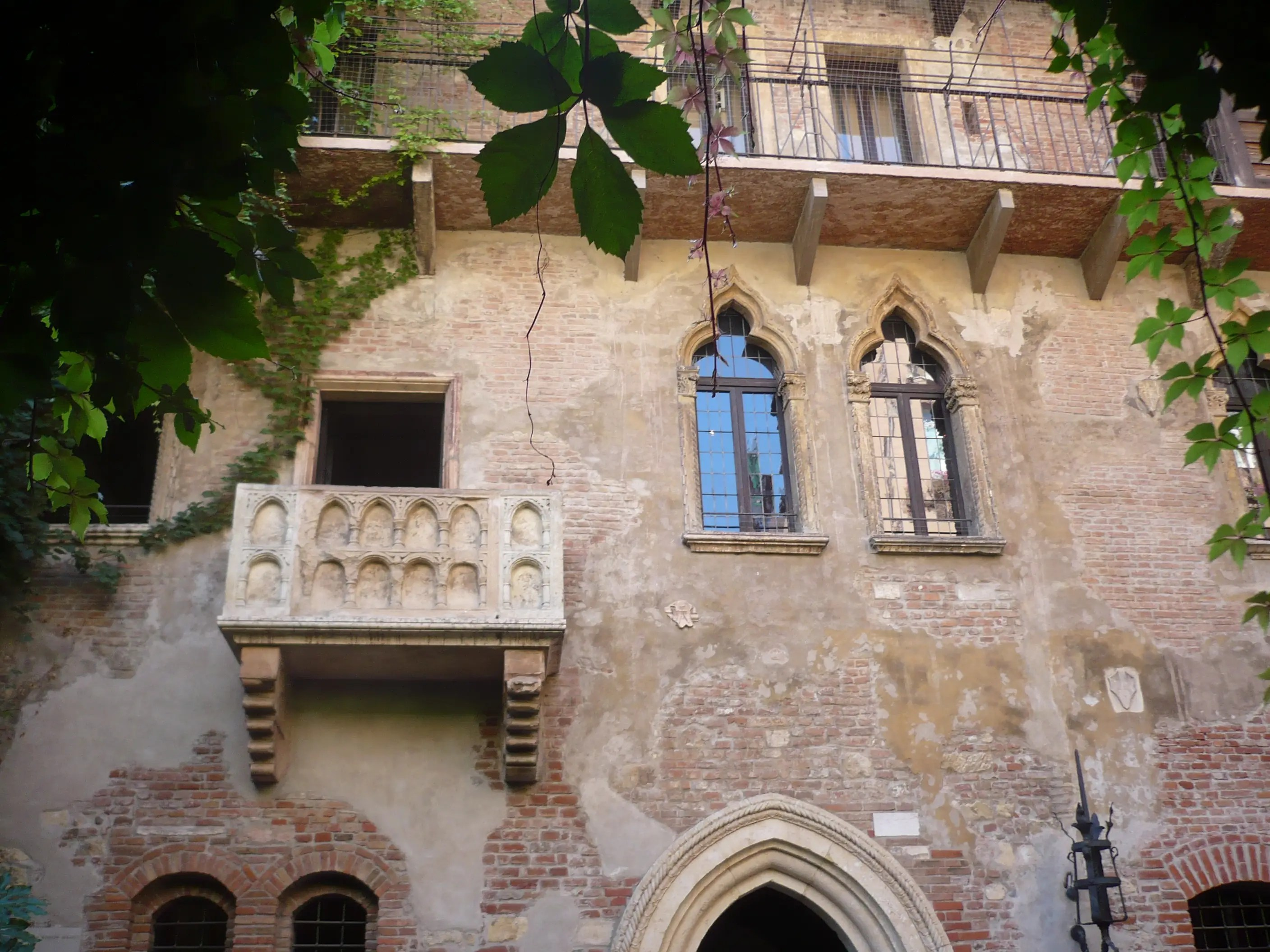 Re-enact the famous Shakespearean scene on Juliet's balcony in Verona.