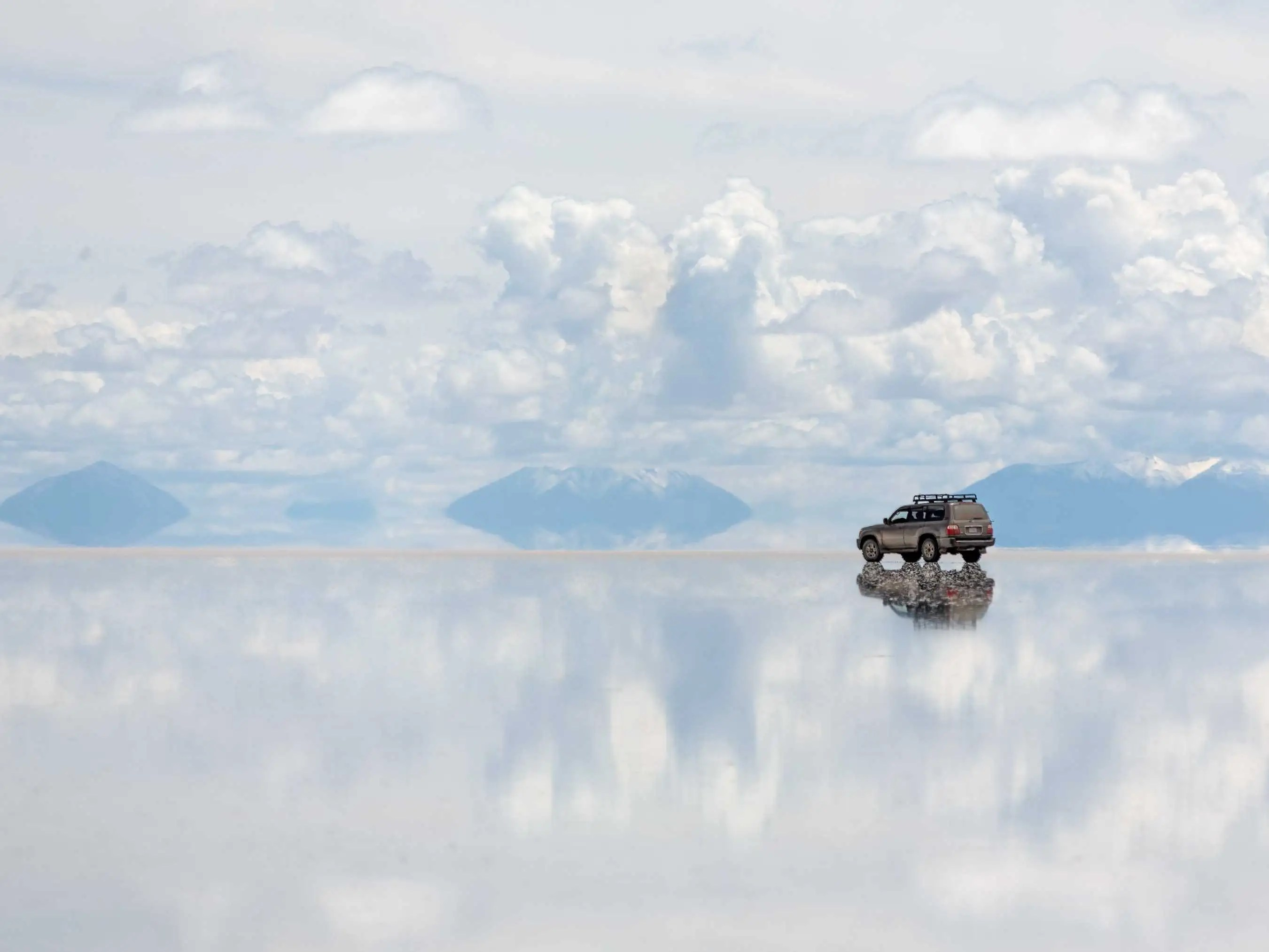 Four wheel drive across Bolivia's Salar de Uyuni, the largest salt flat in the world.