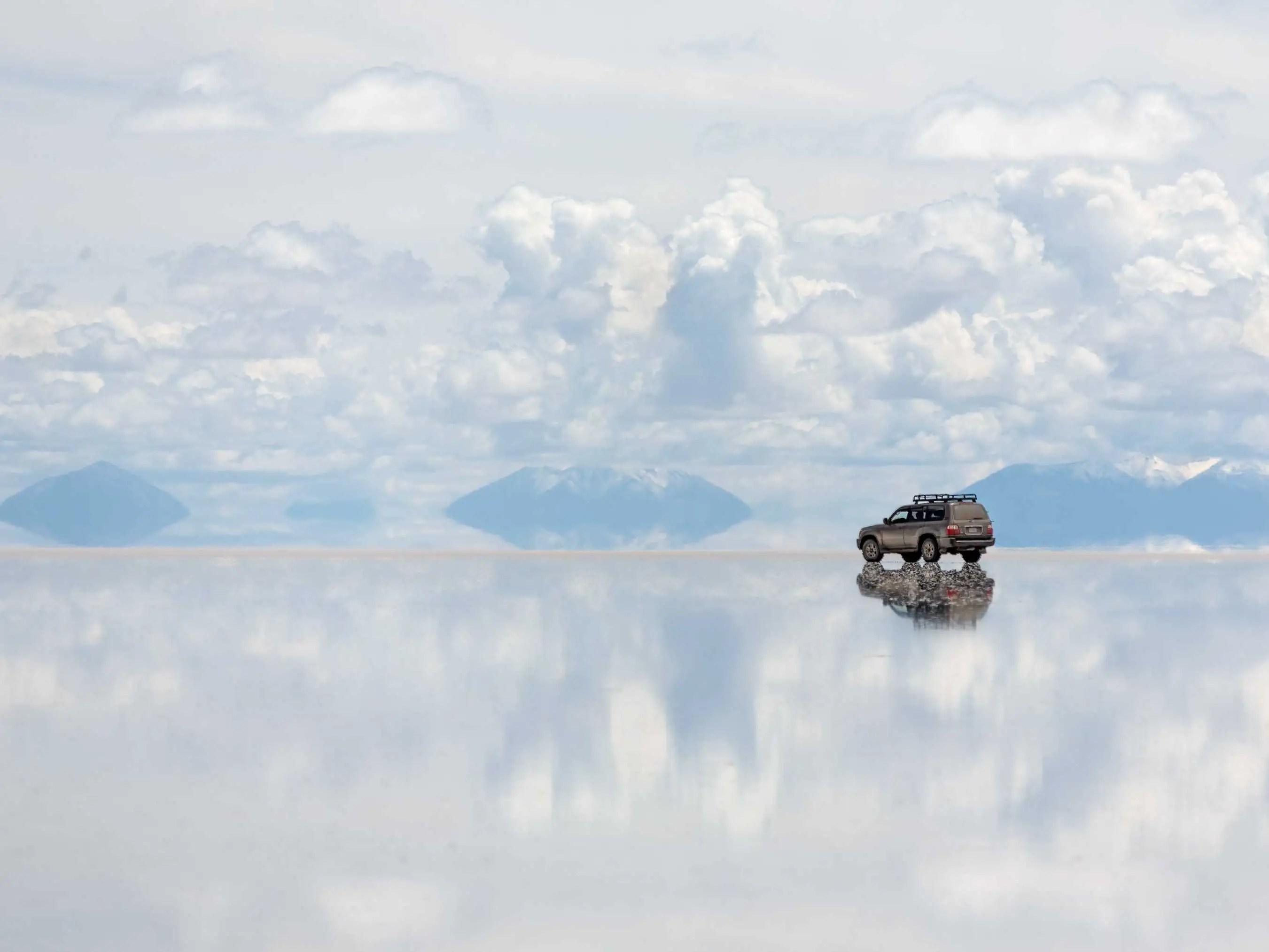 Four wheel drive across Bolivia's Salar de Uyuni, the largest salt flat in the world.