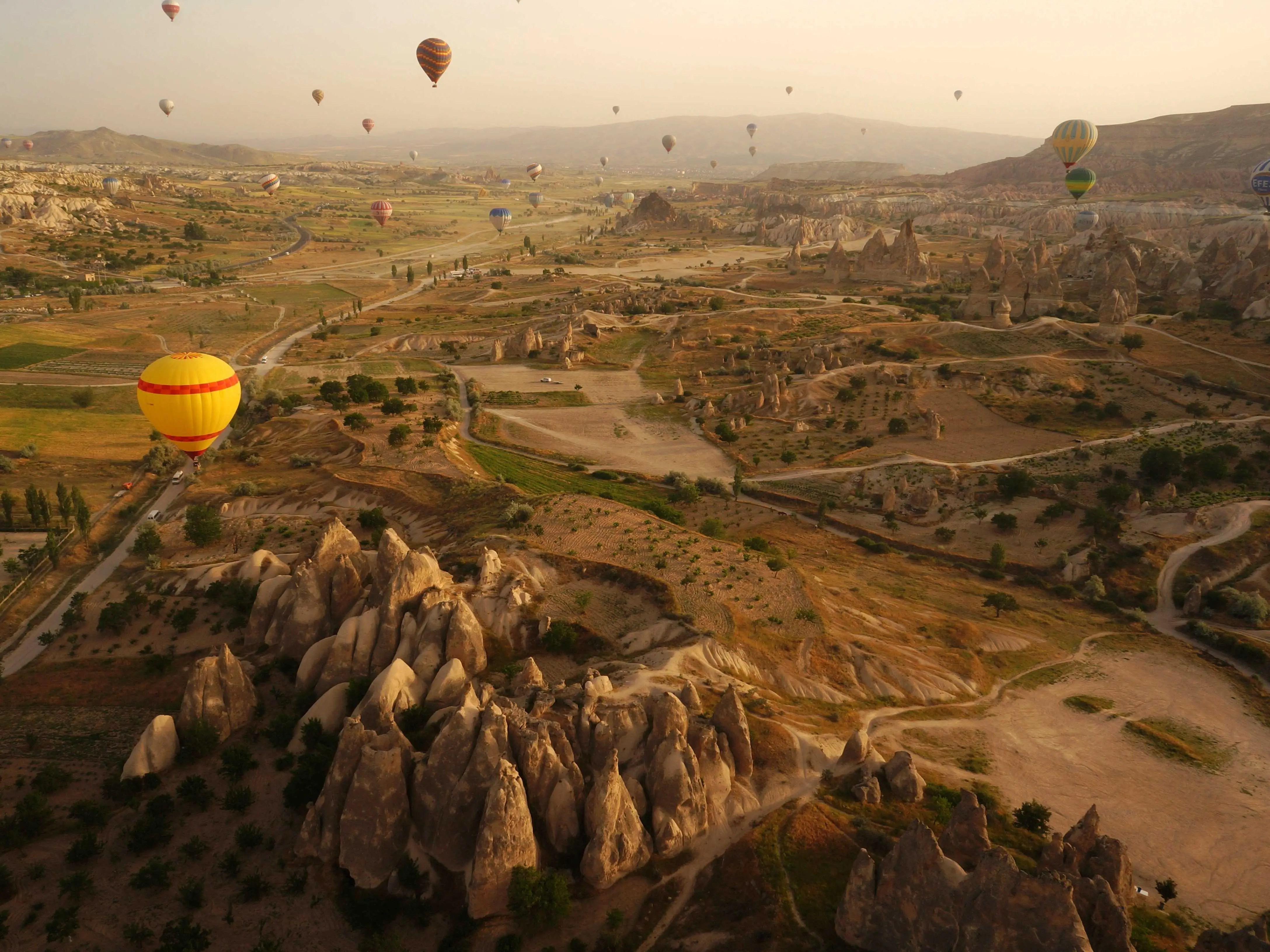 """Göreme National Park and the Rock Sites of Cappadocia is a volcanic landscape created entirely from erosion that eventually formed mountain ridges, valleys, and pinnacles nicknamed """"fairy chimneys"""" across Cappadocia, Turkey."""