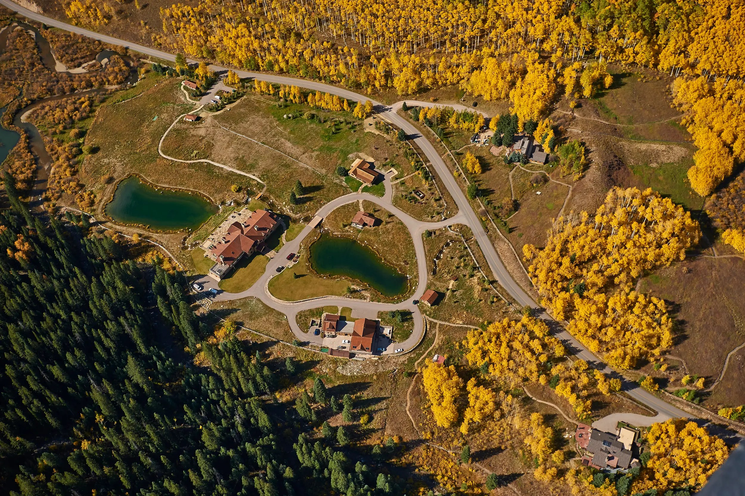 Multiple ponds and private forests are part of the property's appeal.