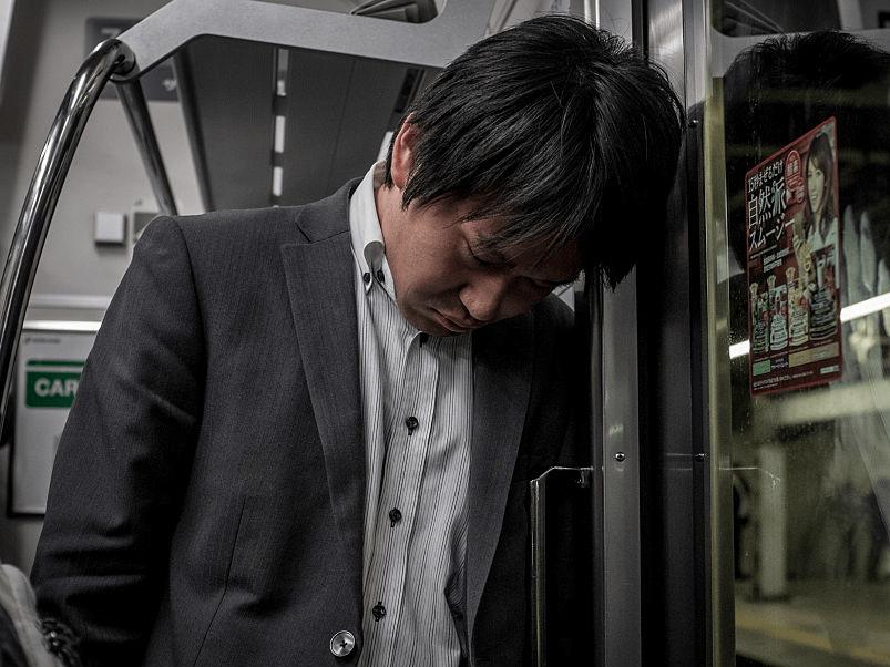 sleeping tired work businessman burnout stress