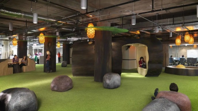 Groupon's office in Chicago features breakout spaces with indoor swings and island-themed areas to relax — random boulders included.
