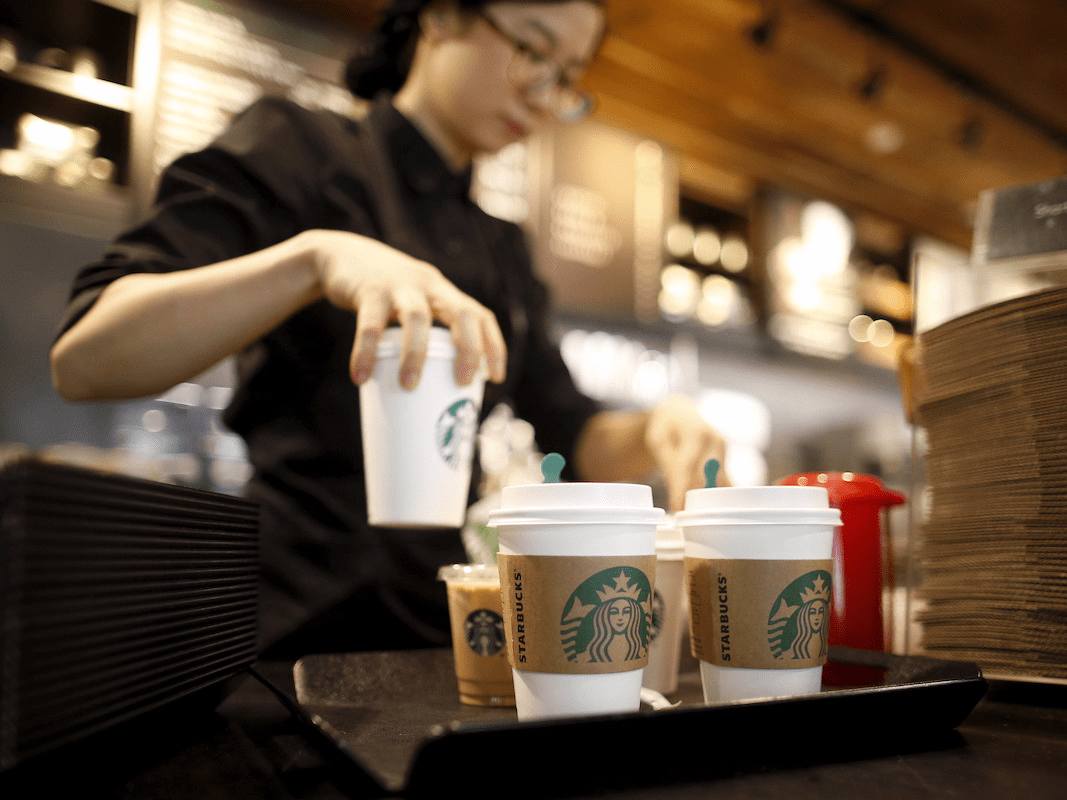 A staff serves beverages at a Starbucks coffee shop in Seoul, South Korea, March 7, 2016. Picture taken March 7, 2016.