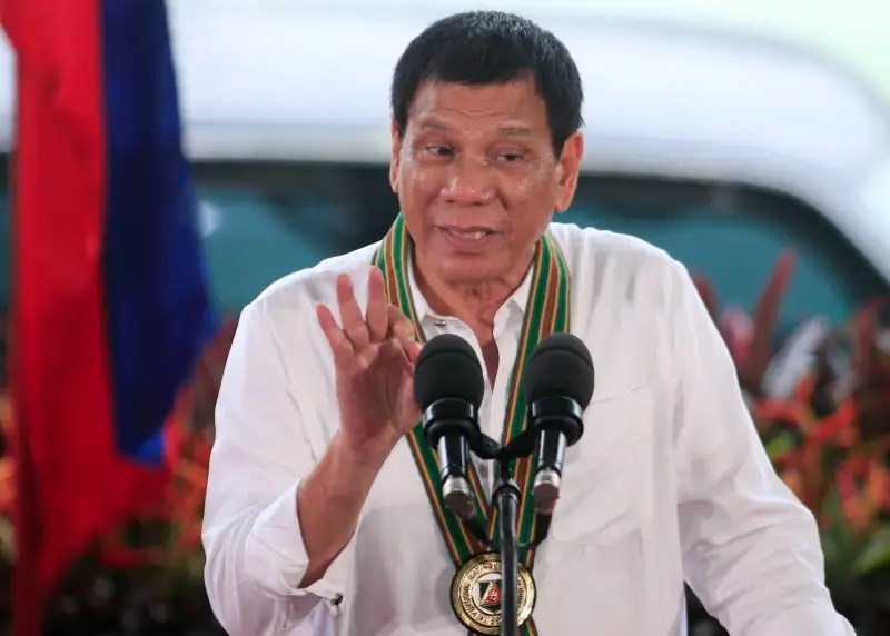 Philippines President Rodrigo Duterte gestures as he delivers a speech to the members of the Philippine Army during a visit at the army headquarters in Taguig city, metro Manila, Philippines October 4, 2016. REUTERS/Romeo Ranoco