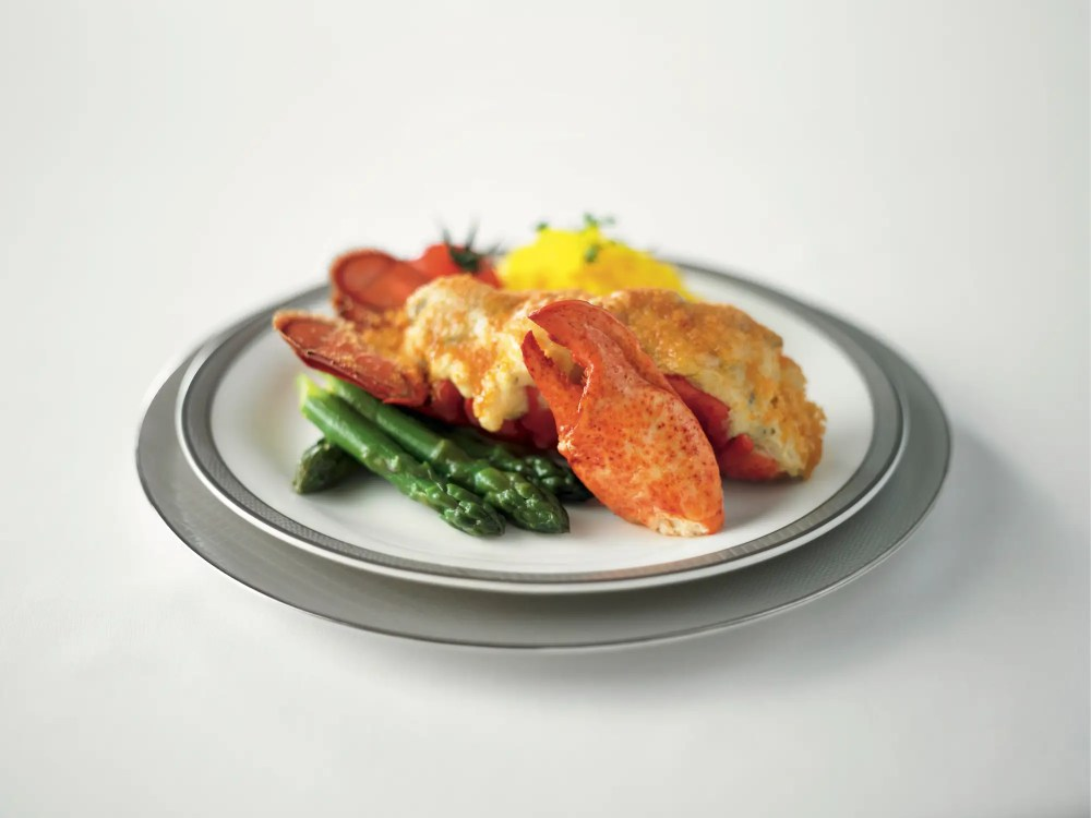 The food is served in the suites are a mix between western cuisine like this lobster thermidor or...