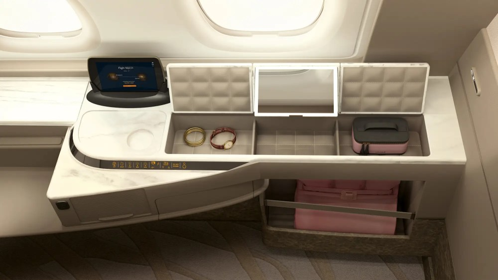 In addition to a 32-inch entertainment display, the suites also come with some handy storage bins.