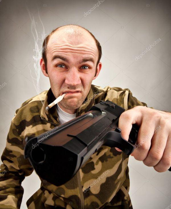 Дерзкий бандит с пушкой — Стоковое фото © Nomadsoul1 #5226922
