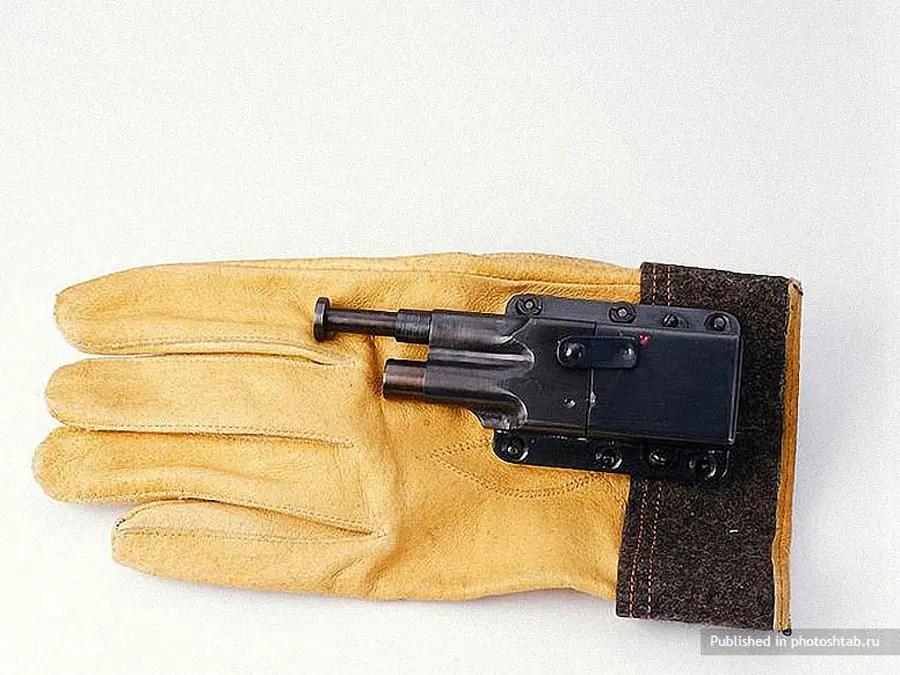 A tiny gun hidden on the inside of a glove.