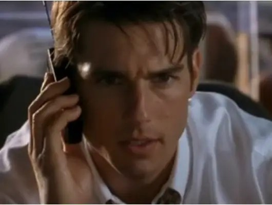 """1996: Tom Cruise's character used his cell phone (note the antenna) to wheel and deal in """"Jerry Maguire."""""""
