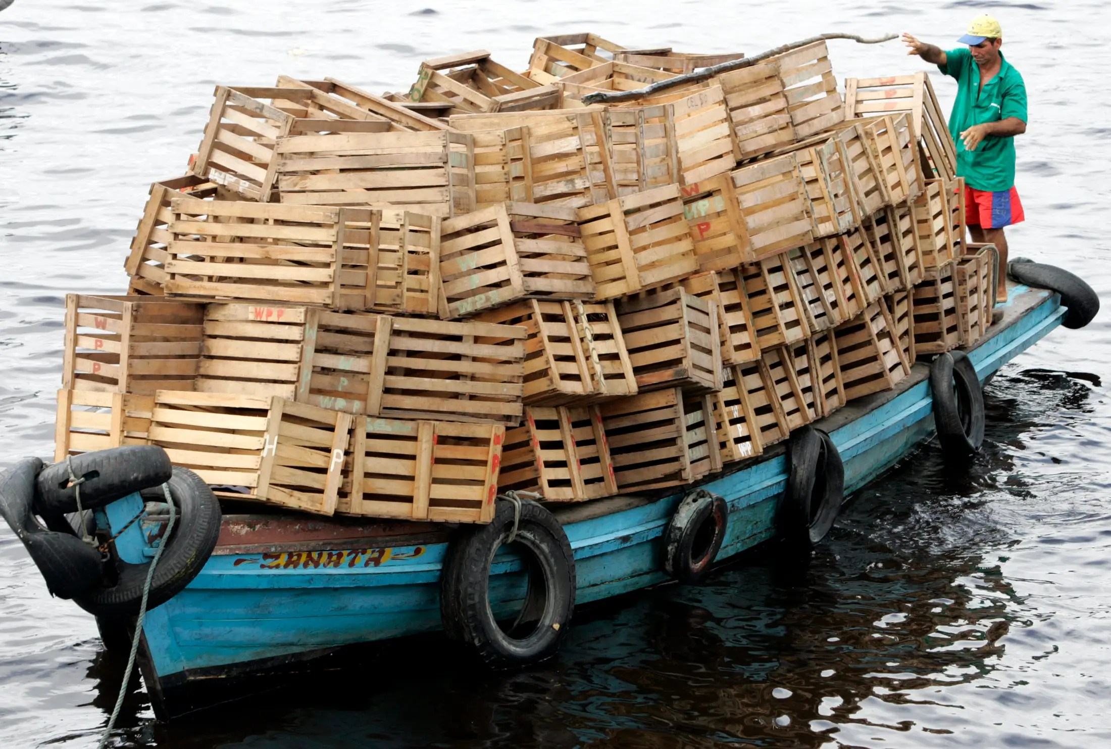 A riverboat in Amazonas, Brazil is overloaded with empty boxes.