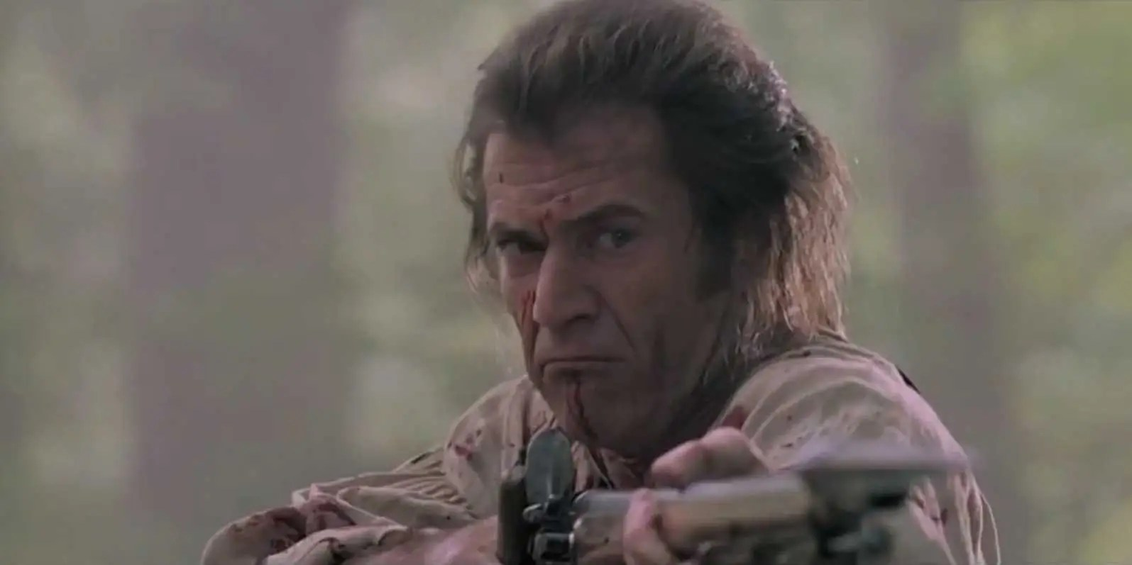 """The Patriot"" (2000): Farmer Benjamin Martin (Mel Gibson) forms a group of Carolina patriots to uprise against the British troops during the American Revolution after his son Gabriel (Heath Ledger) is captured."