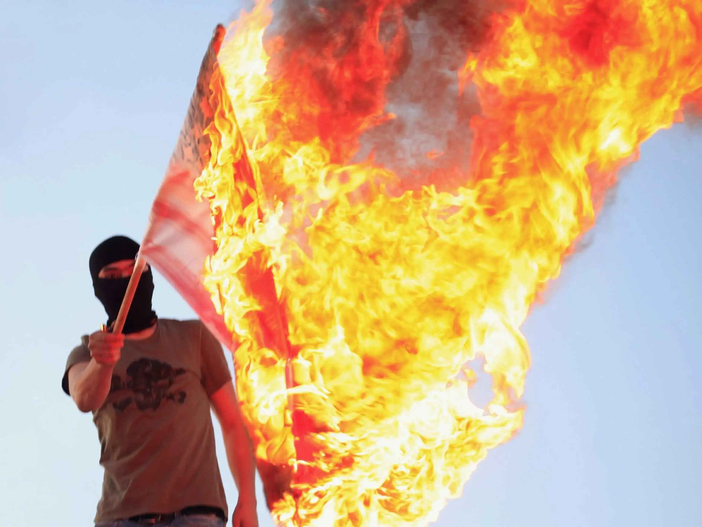 libya protester burning flag