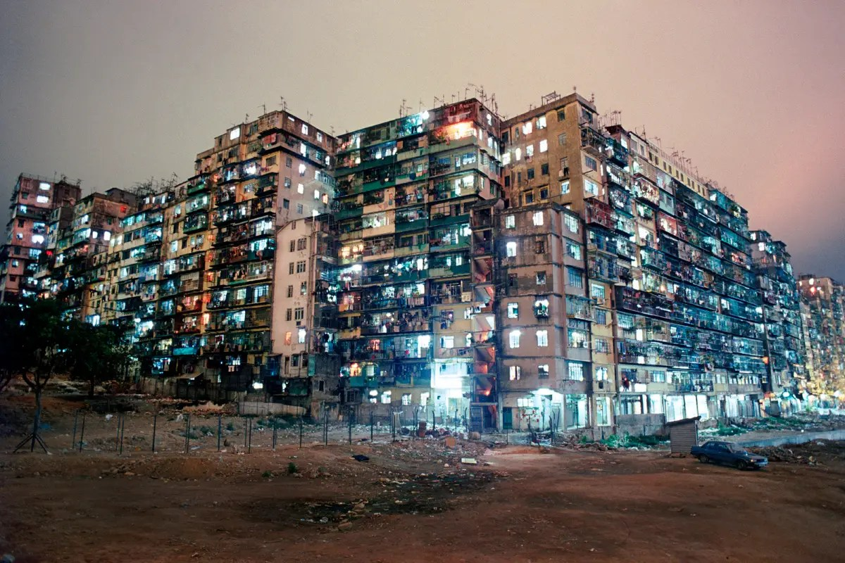 Kowloon Walled City was a densely populated, ungoverned settlement in Kowloon, an area in northern Hong Kong. What began as a Chinese military fort evolved into a squatters' village comprising a mass of 300 interconnected high-rise buildings.