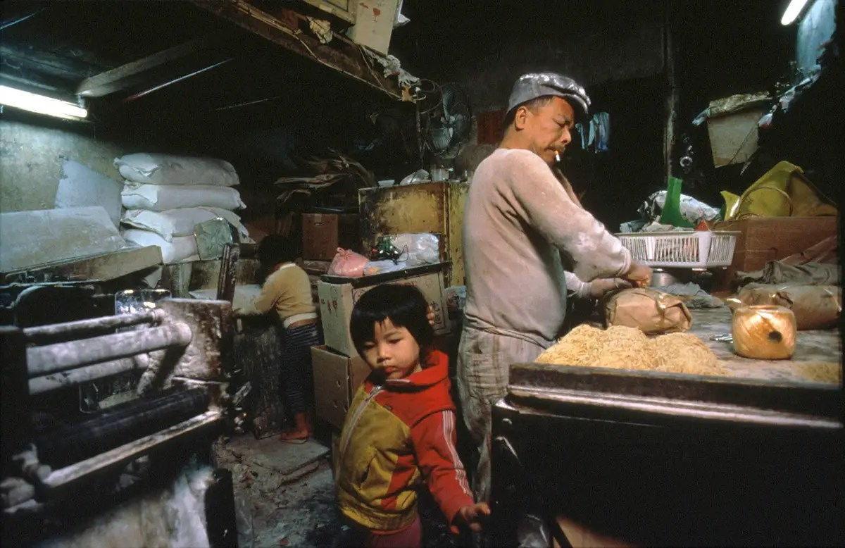 Hui Tuy Choy opened his noodle factory in 1965. He chose the Walled City because the rents were low and you didn't need a license to open a store. In Hong Kong, shop owners had to get licenses from the labor, health, and fire departments.
