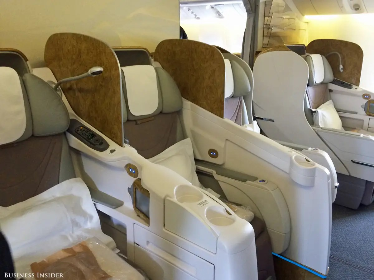 Business class looked pretty cushy, with reclining seats, reading lamps, and big TV screens.