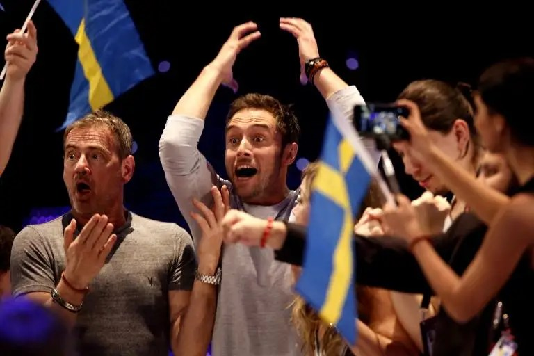 Sweden's Mans Zelmerlow (C) celebrates winning the 60th Eurovision Song Contest final on May 23, 2015 in Vienna