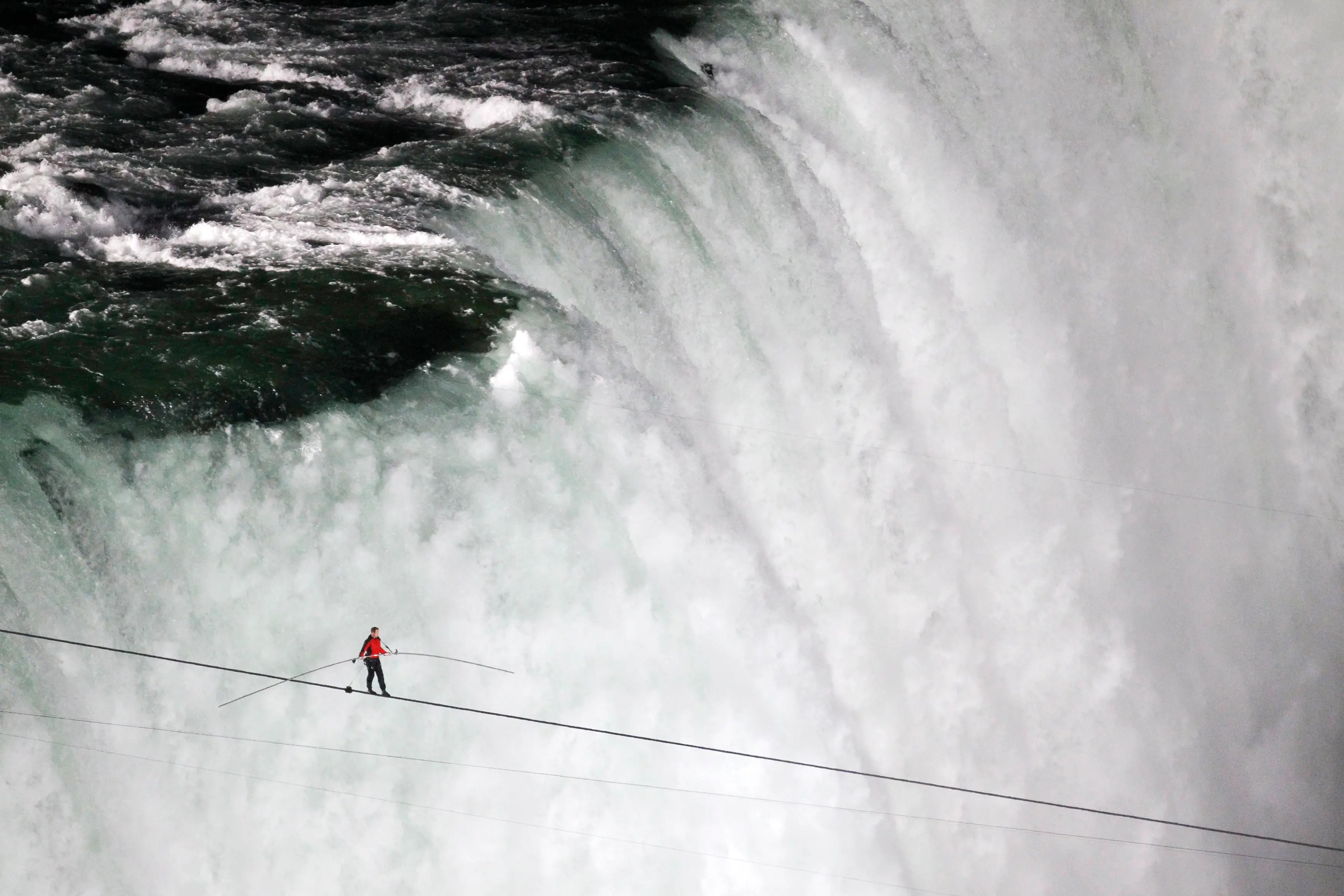 Tightrope walker Nik Wallenda walks the high wire from the U.S. side to the Canadian side over the Horseshoe Falls in Niagara Falls, Ontario.