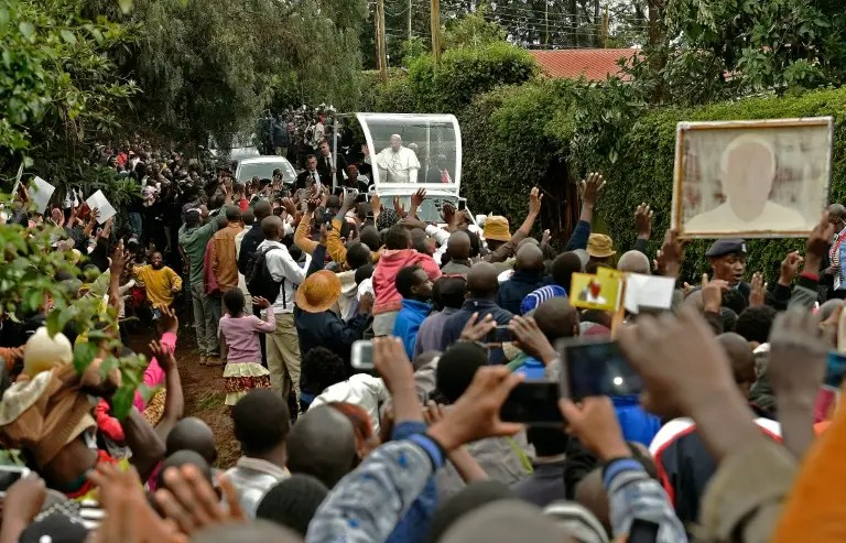 Residents of Kangemi slum, home to more than 100,000 people who live in shacks without sewerage, welcome Pope Francis during his visit on November 27, 2015