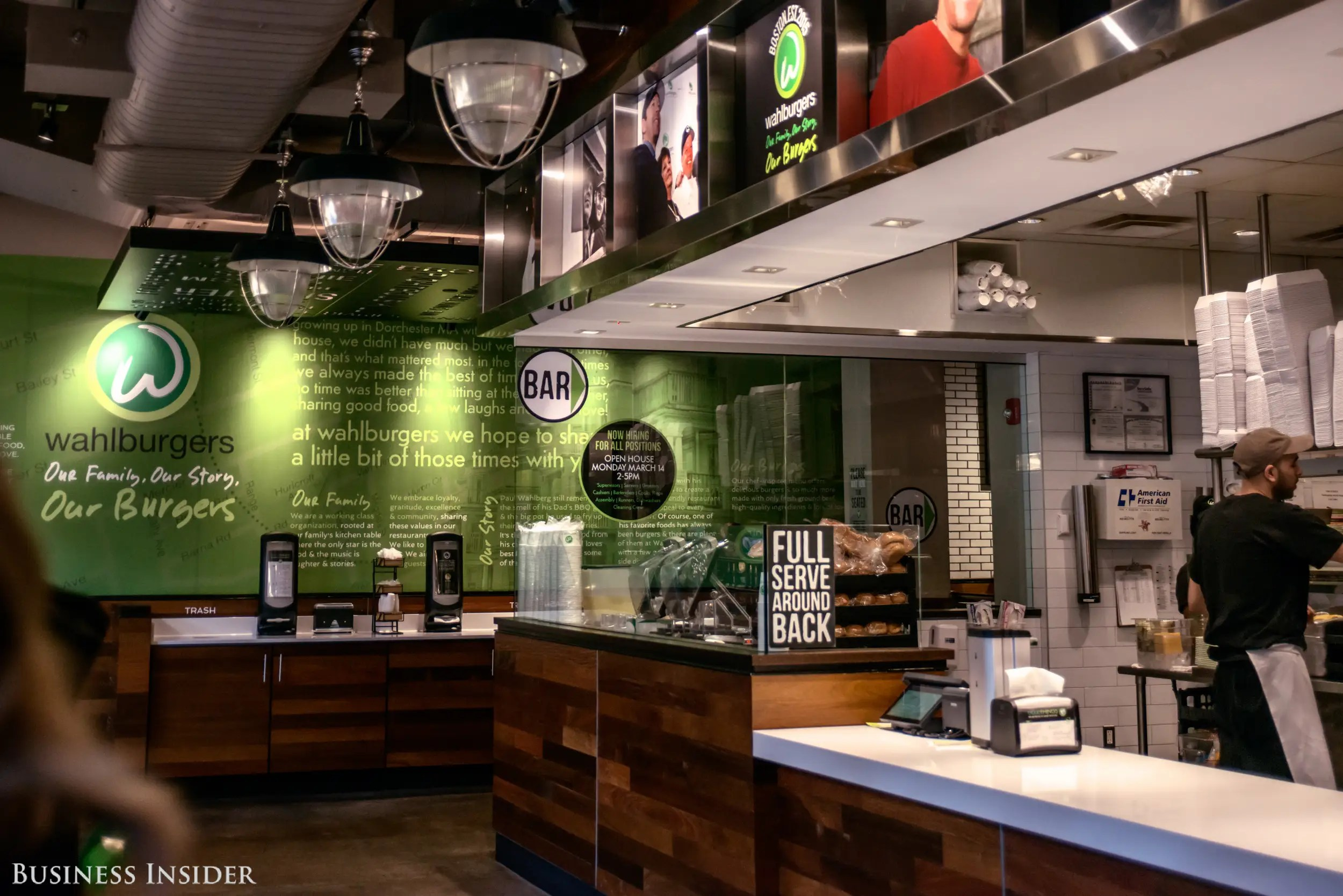 The interior is very slick and modern, and it has the ubiquitous fast-casual combo of warm woods and sleek brushed steel. The look is almost dated at this point, given how many Chipotle and Shake Shack clones have followed suit. Green is the dominant color at Wahlburgers, however, with most surfaces sporting some shade or another.