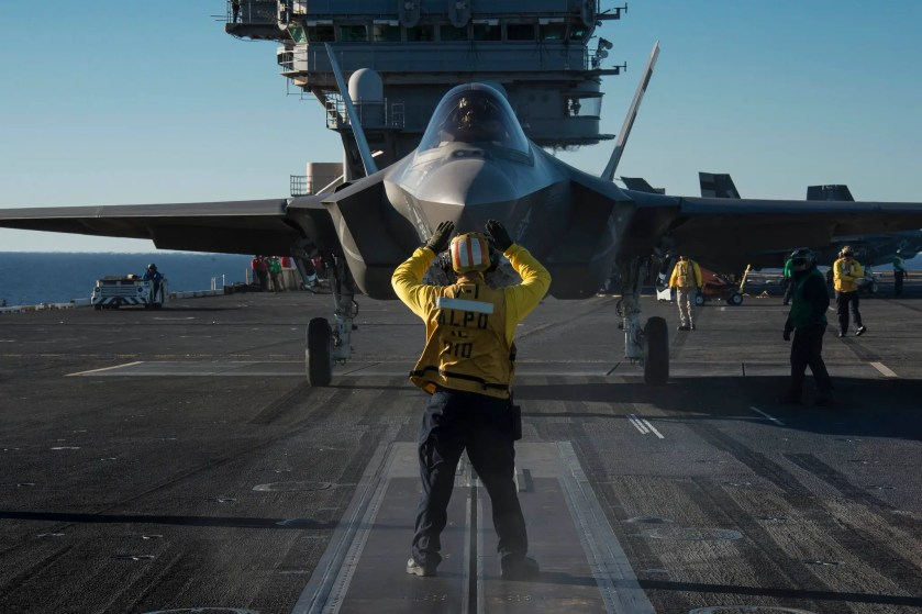 An F-35C Lightning II carrier variant joint strike fighter is prepared for launch aboard the aircraft carrier USS Nimitz.