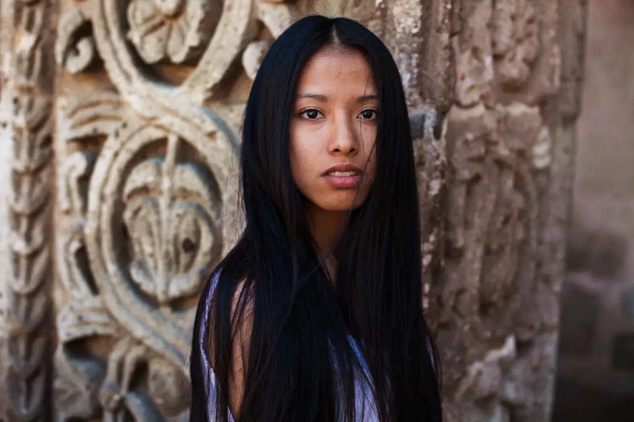 """""""I walk hours every day, in very different environments and I try to find relevant faces and stories for each place,"""" Noroc tells Tech Insider. This woman was in Peru."""