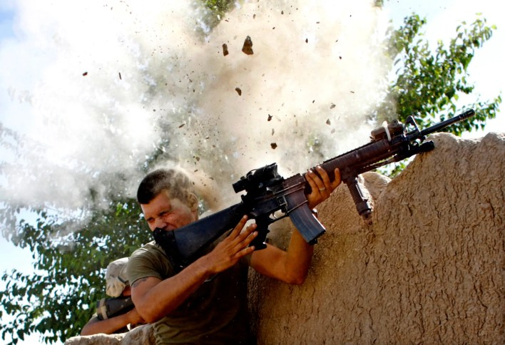 Sgt. William Olas Bee, a US Marine from the 24th Marine Expeditionary Unit, has a close call after Taliban fighters open fire near Garmsir in Helmand Province, May 2008.