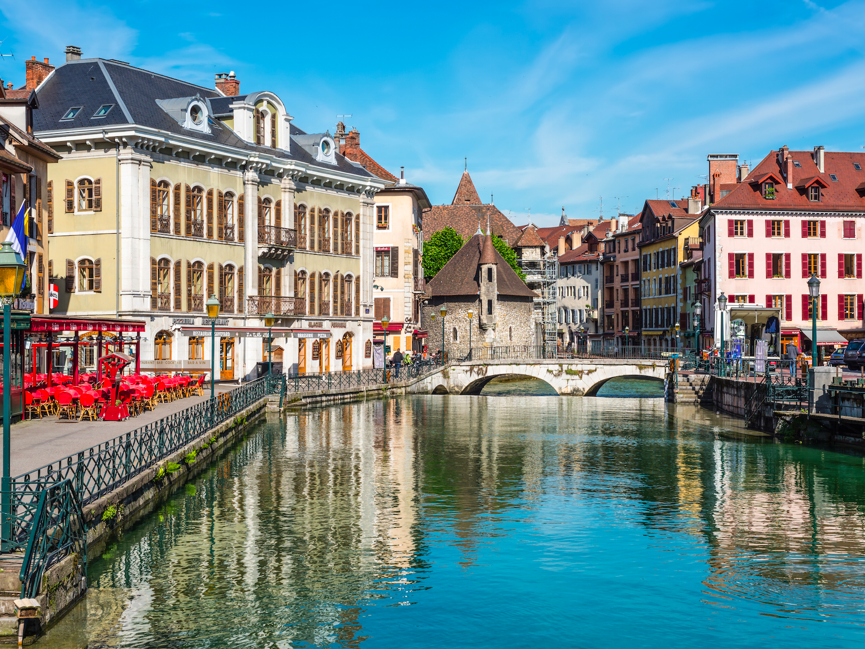 In the old town of Annecy, France, travelers are greeted by pastel-painted houses and cafes lining a lovely lakeshore. Hang out at one of its many outdoor eateries, cycle along the water, or admire historical sites like the Château d'Annecy.