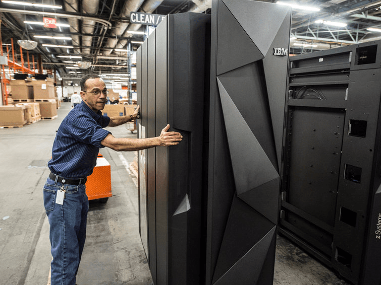 A worker guides the first shipment of an IBM System Z mainframe computer in Poughkeepsie, New York, U.S. March 6, 2015. Picture taken March 6, 2015. Jon Simon/IBM/Handout via REUTERS