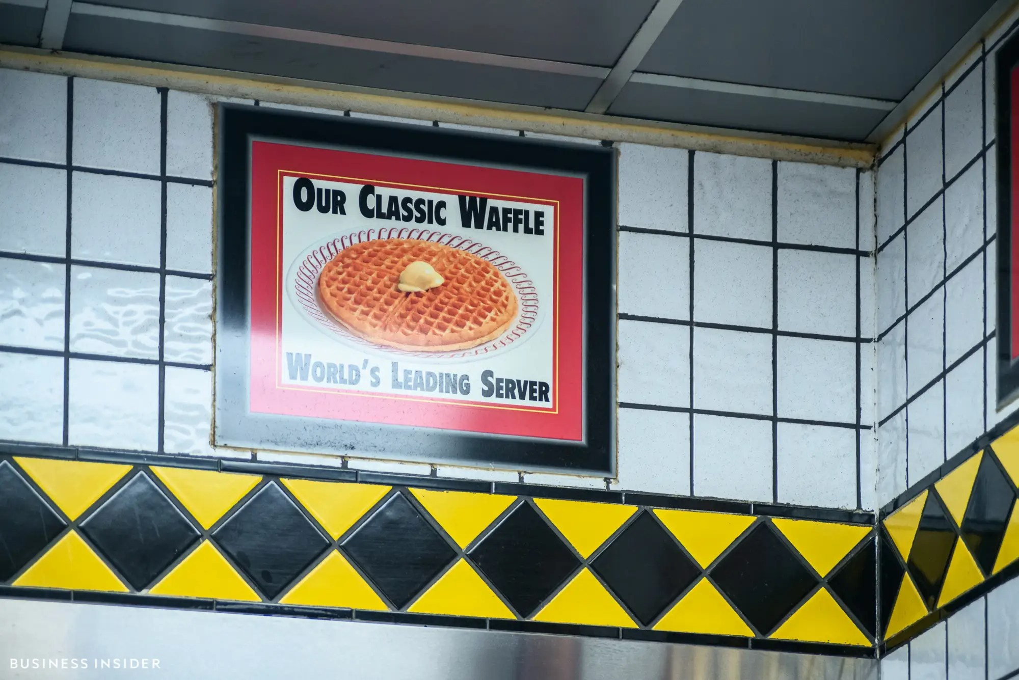 The walls are dotted with greasy-spoon-style diner decor, with signs hawking the chain's titular menu item.