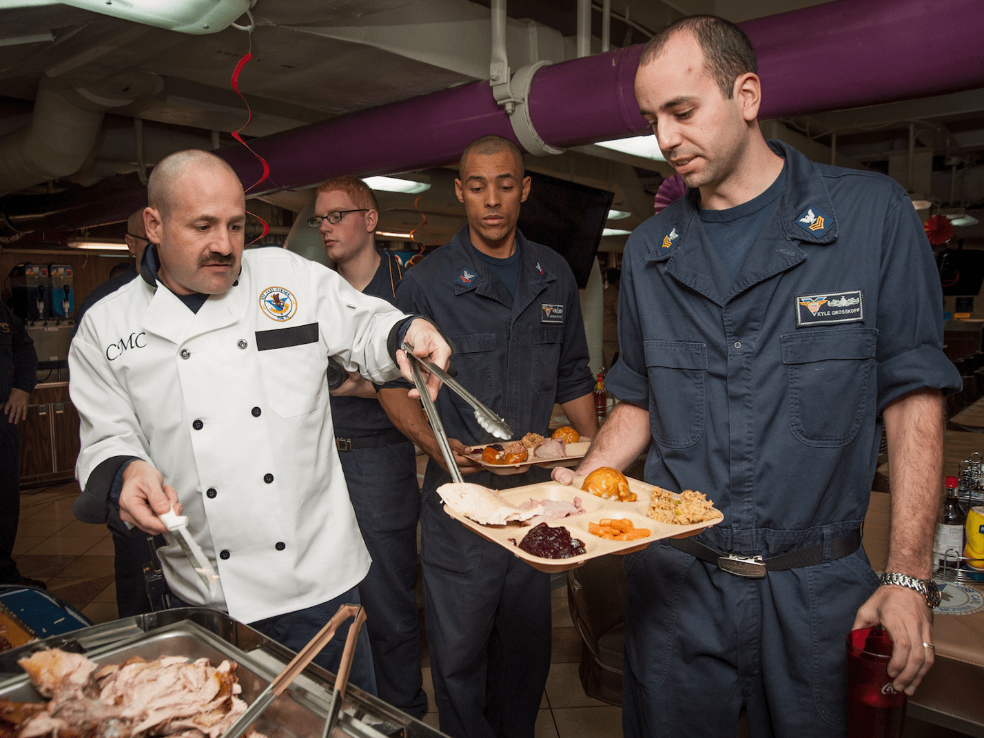 The Navy provides Thanksgiving turkey for crew members out at sea.