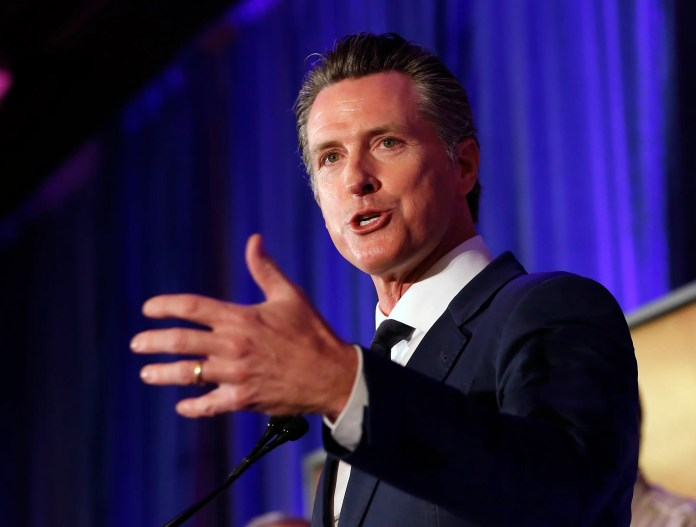 California Gov. Gavin Newsom speaks at the California for All Emergency Management Preparedness Summit, Monday, June 3, 2019, in Sacramento, Calif. Newsom said Monday that the Defense Department as agreed to provide information from a Cold War-era military satellite to help spot wildfires, while the defense secretary also gave the California National Guard blanket approval through the year's end to use unmanned drones to map fires, count destroyed houses and spot survivors. (AP Photo/Rich Pedroncelli)