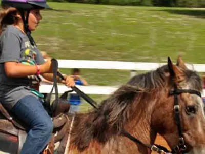 At Dude Ranch Camp, kids ride horses, zipline, and more.