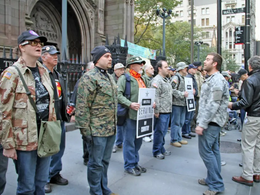 The formation stopped a couple of times on the way to Zuccotti Park. Here they are holding a moment of silence for Scott Olsen. People watching whispered to each other,