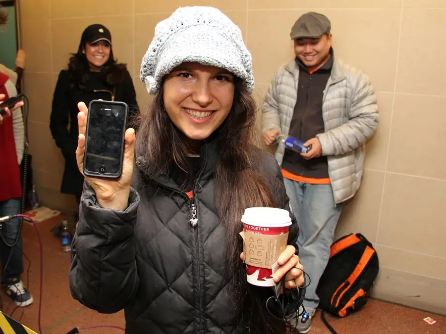 Jessica Mellow had been there since 6 AM. She's such a big fan that she waited in line for the iPhone 4S for 18 days and blogged about it at iPhonewhatever.com