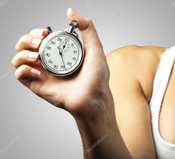 Женщина толкая секундомер — Стоковое фото © Aaron_Amat ...