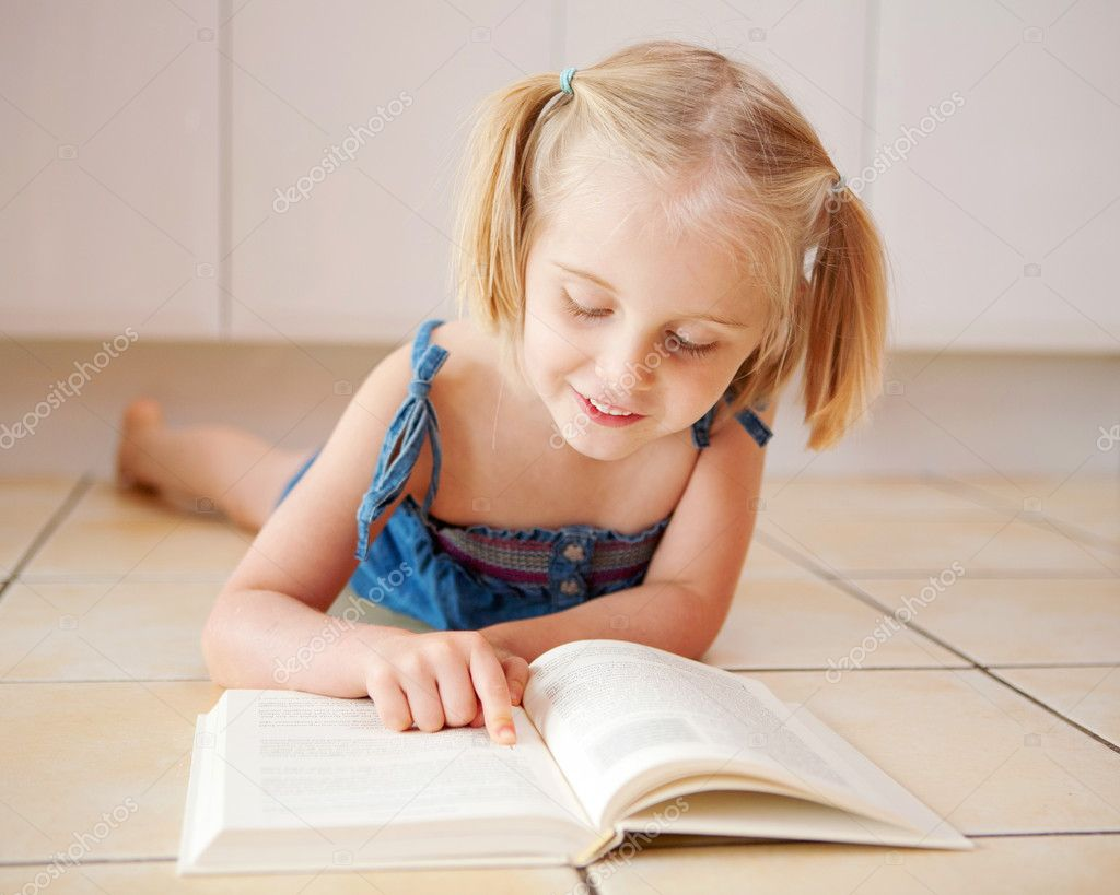A Little Four Year Old Girl Reading