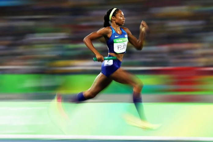 Allyson Felix competing in the 4*400m relay in the 2016 Rio Olympics.